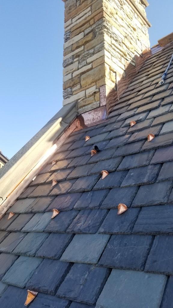 Copper snow hooks on a slate roof